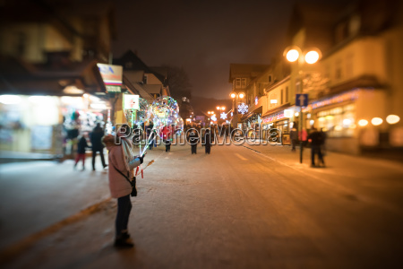 lonely girl selling light baloons at