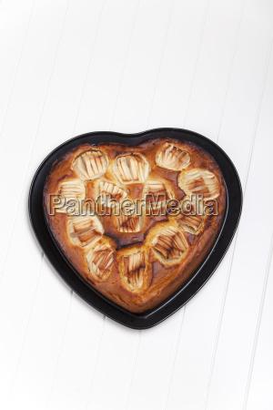 heart shaped apple pie on white