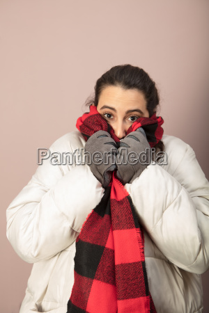 cold woman snuggling down into her