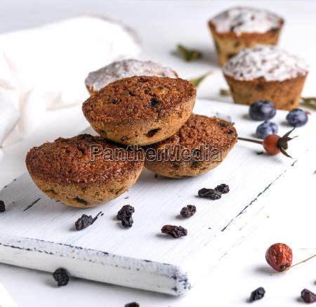 baked round muffins with raisins on