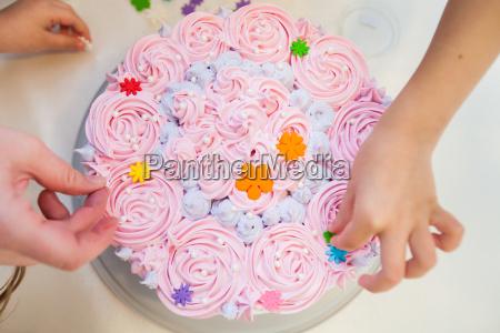 decorating birthday cake