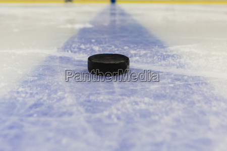 blue line with puck on ice