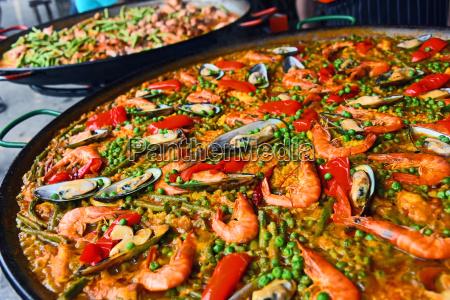 spanish paella prepared in the street
