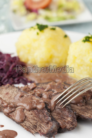 sauerbraten with red cabbage on a