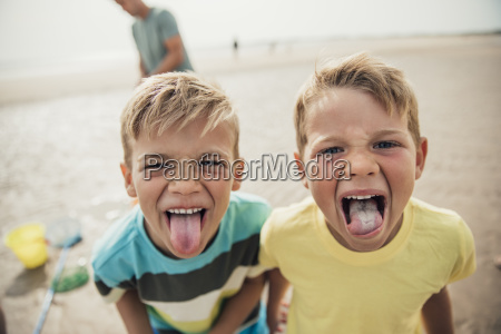 little boys sticking their tongues out
