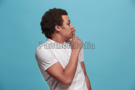 the young man whispering a secret