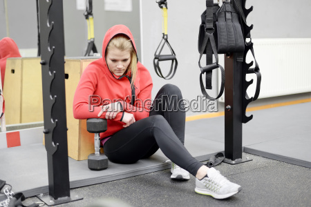 exhausted woman in the gym