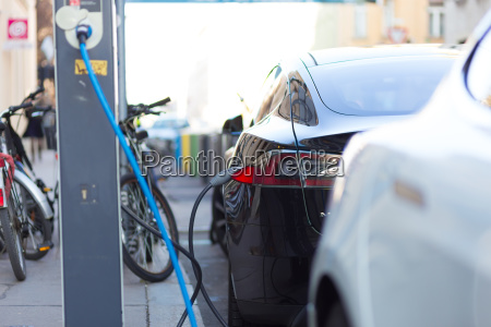 charging modern electric car on the