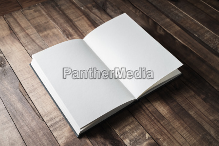 book on wooden table