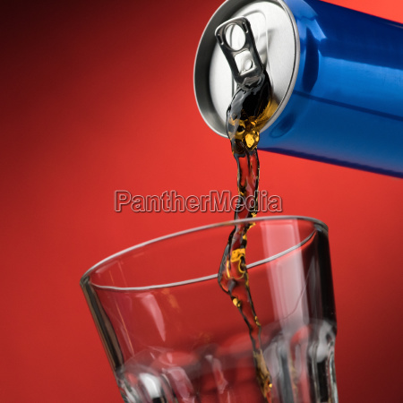 pouring a soft drink in a