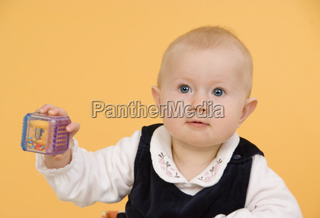 toddler with rattle