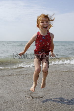 child honked on the beach in