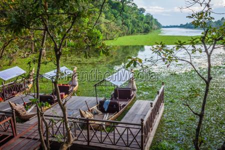 cambodian traditional boats near the bayon