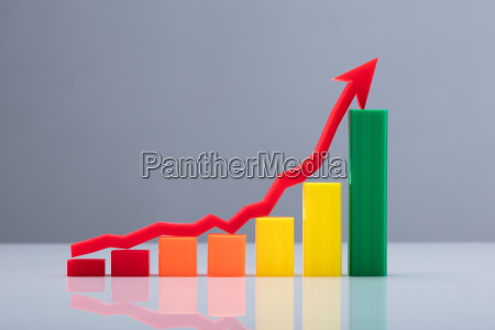 multi colored business graph with arrow