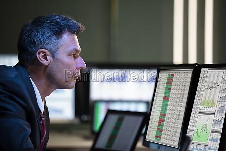 stock market broker analyzing graph on