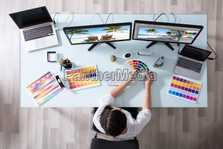 designer using color swatch while working