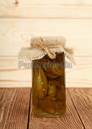 jar of pickled green jalapeno peppers