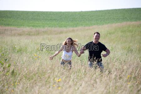 happy people on summer meadow