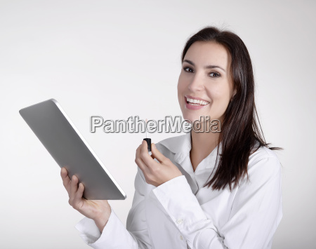 businesswoman with digital tablet and lipstick