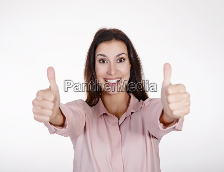 businesswoman shows thumbs up