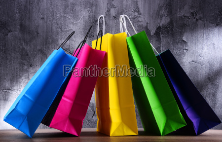 composition with colorful paper shopping bags