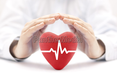 heart pulse covered by hands health