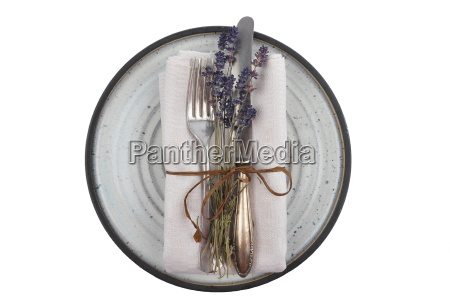 old cutlery with lavender on plate