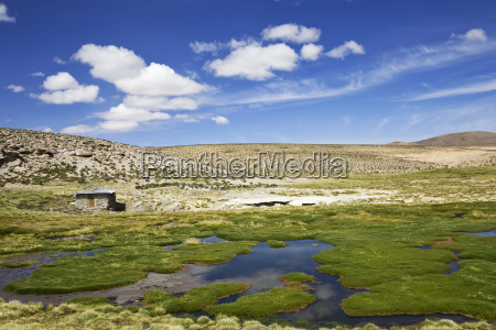 mountain landscape with thermal bath at