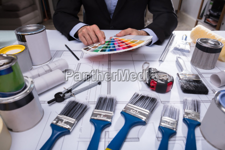 architects hand choosing color from swatch