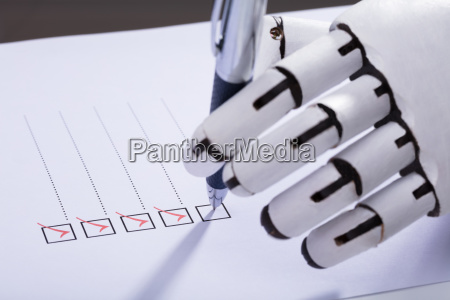 robot ticking off checkboxes on document