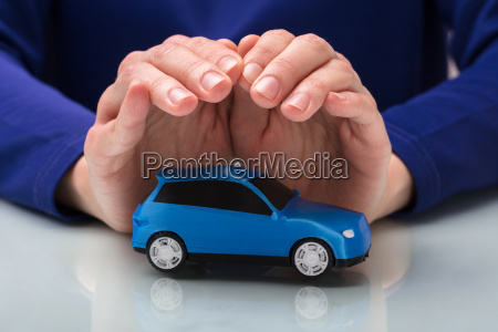 person protecting small car