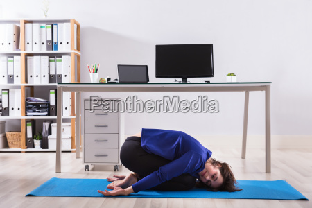 businesswoman doing workout in office