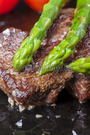 beef steak and green asparagus in