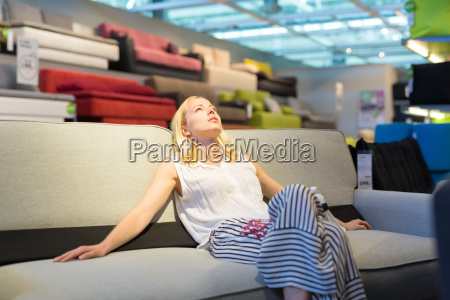 woman shopping for new sofa in