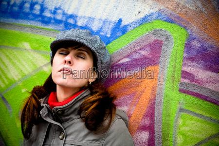 woman on wall with graffiti