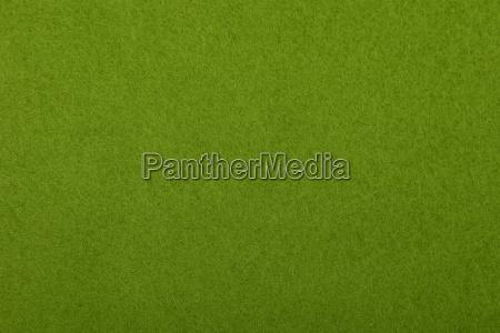 green felt background texture close up