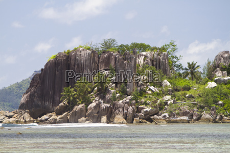 granite formations with coconut trees island