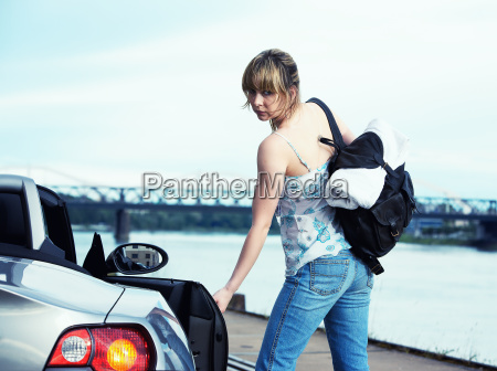 young woman with convertible at a