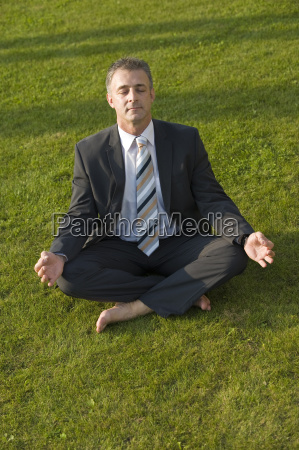 business man is doing yoga in