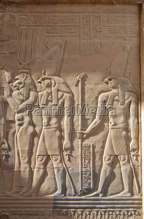 egyptian engraved gods image on wall