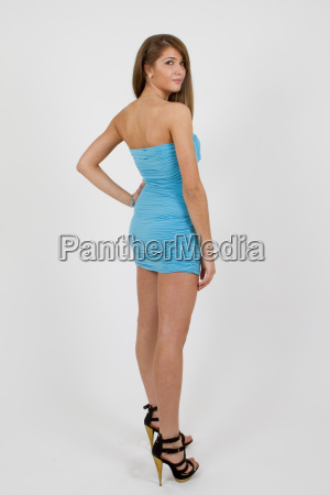 young woman in blue dress and