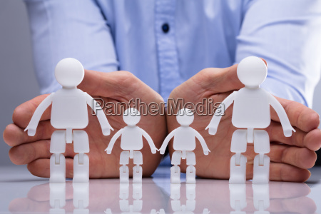person protecting family human figures