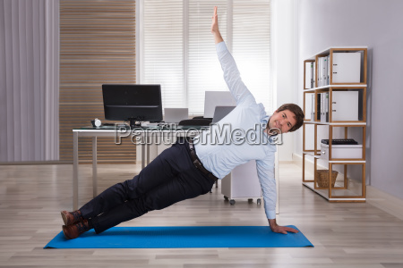 businessman doing workout on exercise mat