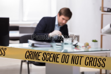 forensic expert searching for crime evidence