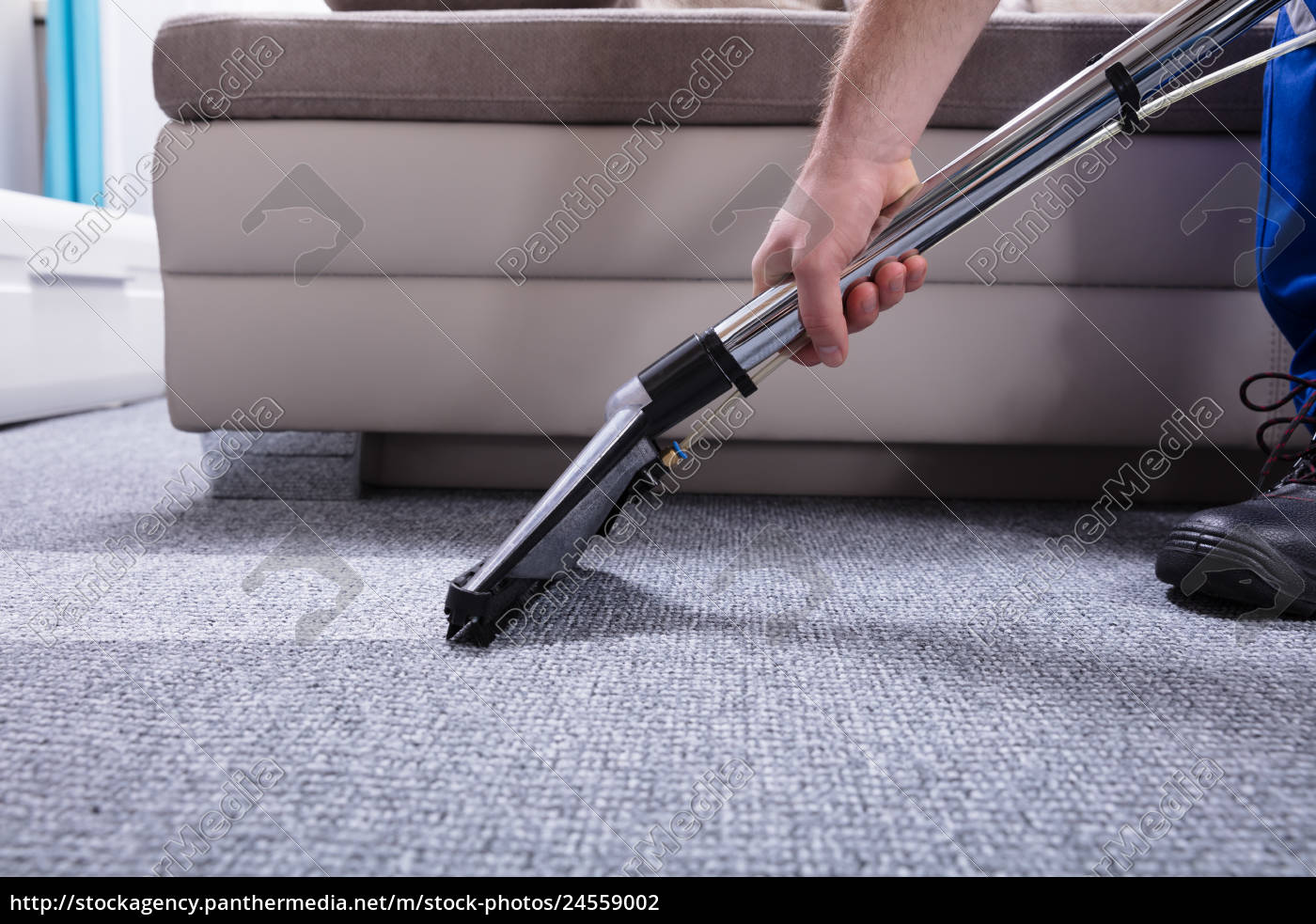 Janitor Cleaning Carpet With Vacuum