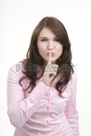young woman gesture for silence secret