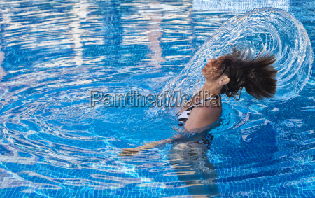 woman in swimming pool creates a