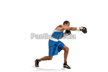 sporty man during boxing exercise photo