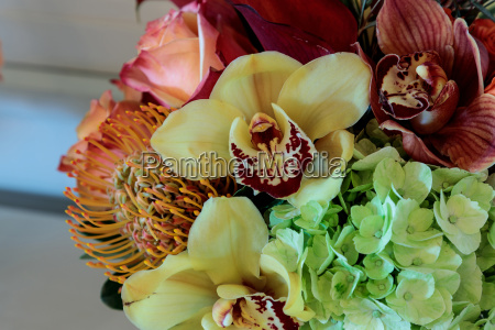bouquet of flowers including roses orchids
