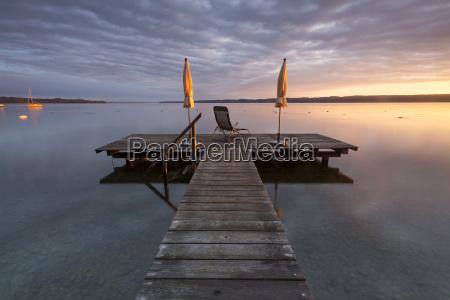 sunrise boardwalk at lake starnberg near